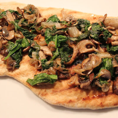 Grilled green onion on flatbread