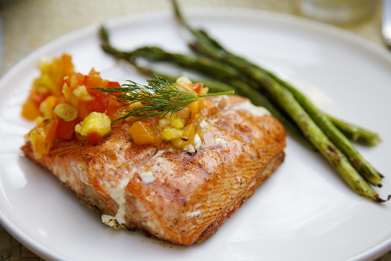 Salmon with a pineapple, mango, and strawberry salsa