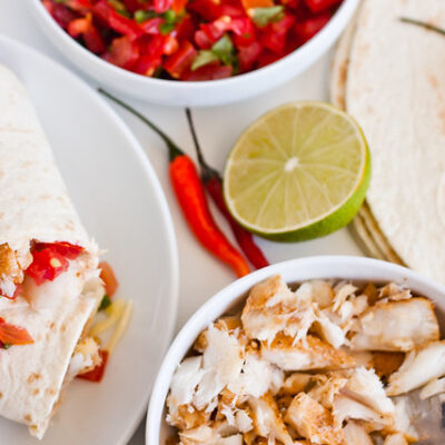 Grilled fish tacos with roasted chile and avocado salsa