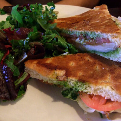 Roasted turkey panini with pesto, fontina and roasted peppers